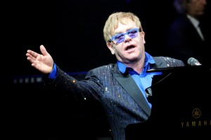 This picture taken on November 25, 2012 shows pop-rock balladeer Elton John performing at his concert in Wukesong Stadium in Beijing. Elton dedicated his Beijing show to Chinese dissident Ai Weiwei -- a controversial move the artist said on November 26 was unlikely to make the nation's cultural minders happy.   CHINA OUT     AFP PHOTO        (Photo credit should read STR/AFP/Getty Images)